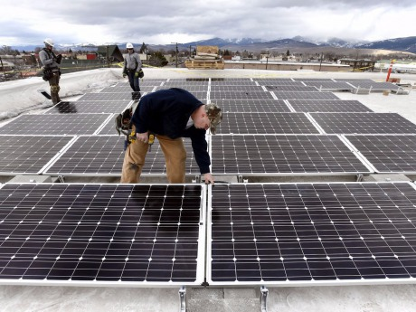 John DeYoung installing solar on the City Life Community Center.