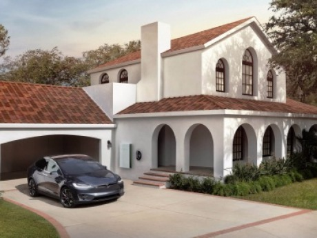 Solar Roof with your Tesla vehicle in the driveway.