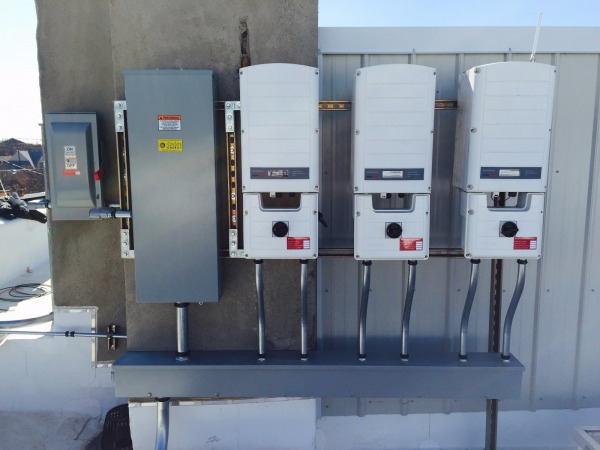 SolarEdge inverters convert the DC power from the solar array into usable AC power for the building's electrical loads.