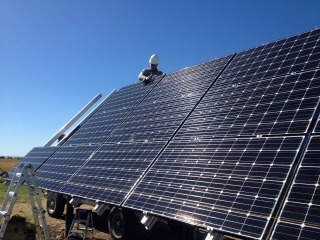 Installing LG 280-Watt solar modules on the Direct Power and Water multi-pole mount rack