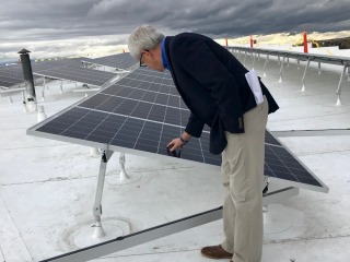 Lt. Governor Mike Cooney makes sure the array is sturdy